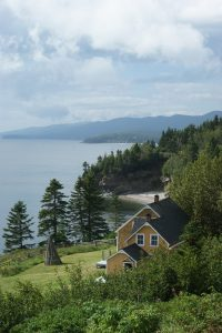 cottage-house-by-lakefront-morning-mist
