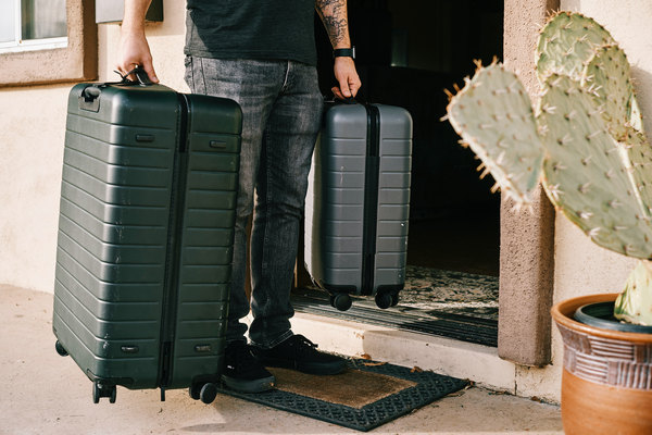 someone entering a condominium unit with luggage